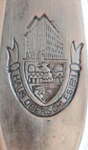 Punca ze znakiem (herbem) własnosciowym Haus Oberschlesien (fragment noża do ryb)